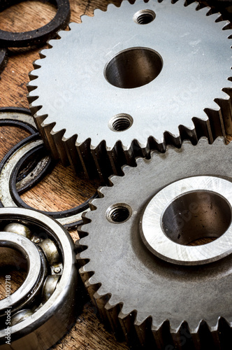 Parts and gears on the old wooden boards
