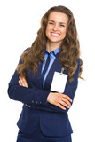 Smiling business woman with badge