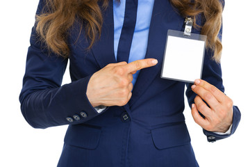 Closeup on business woman pointing on badge