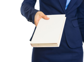 Closeup on business woman giving book