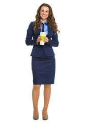 Full length portrait of business woman with cup of coffee