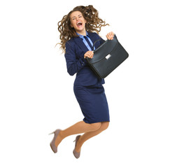 Full length portrait of business woman with briefcase jumping
