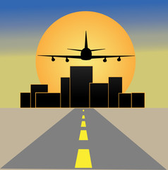 empty road , a big city and airplane at sunset
