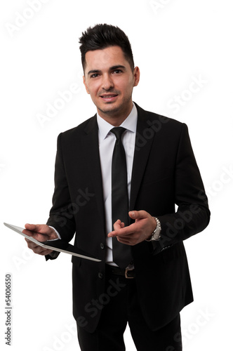 Businessman smiling and pointing at a tablet