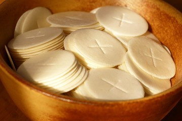 Close-up of communion waffers in a bowl