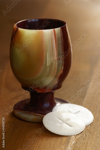 Chalice and communion wafers still life