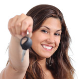 Beautiful woman smiling and holding her car key