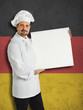 German chef showing the menu