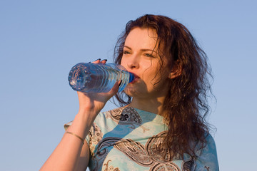 woman drinking water outdoor