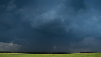 Rainy clouds in sky before thunderstorm time-lapse.