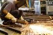 Metal grinding on steel plate in factory