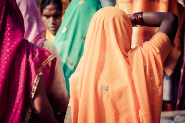 Women with colorful saris in Varanasi, India.