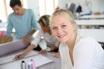 Portrait of smiling student girl in sewing class