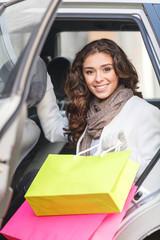 Beautiful shopping addict. Beautiful young women sitting on the