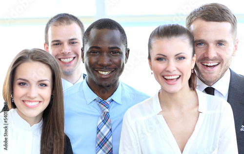 Closeup portrait of a successful business team laughing together