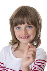 little girl pointing her missing teeth in her hand