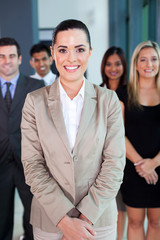 female business leader with team on background