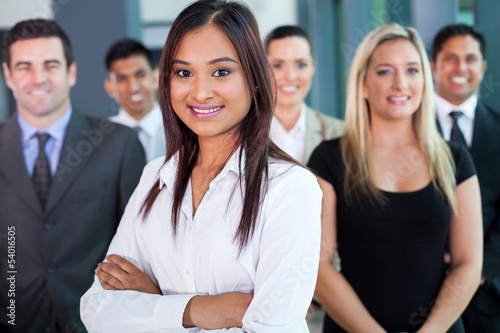 young indian businesswoman and team