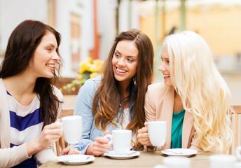 beautiful girls drinking coffee in cafe