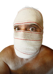 man with head bandages like a Mummy and unsettling look