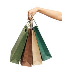 woman hands holding shopping bags