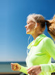 woman doing running outdoors