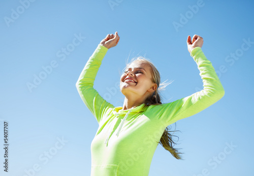 woman runner celebrating victory