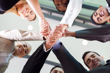 underneath view of businesspeople handshaking