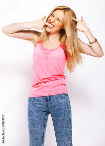 Happy beautiful blonde isolated on white.