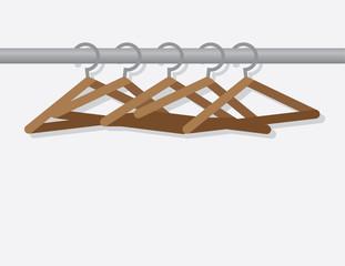 Wooden hangers on metal rod