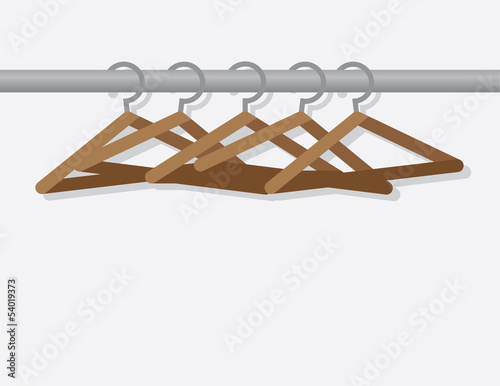 Wooden hangers on metal rod