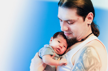 Man holding a newborn baby