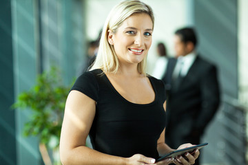 young businesswoman using tablet computer