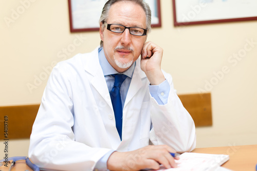 Doctor sitting in his studio