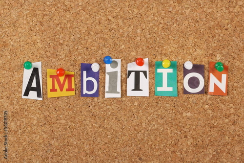The word Ambition on a cork notice board
