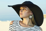Beautiful blond woman in hat. Santorini