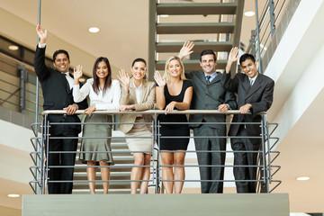 business people waving at stairway