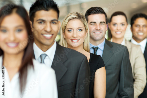 business executives standing in a queue