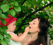 Baby with mother, cherry tree background
