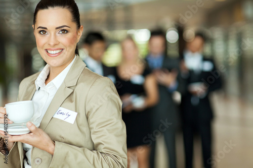 pretty businesswoman having coffee during seminar break