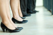 group of businesspeople standing in a row