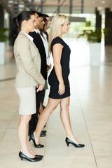 businesswoman stepping forward