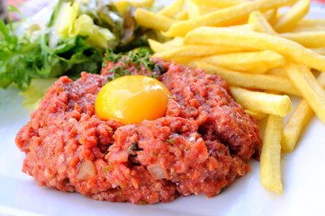 Raw beef with egg and fries