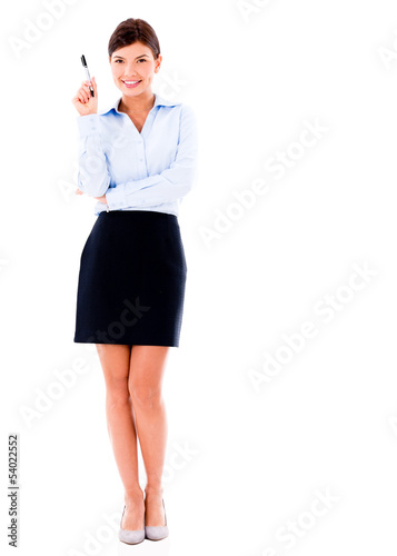 Business woman pointing with a pen