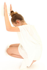 Tween Girl Hiding Against White Wall