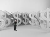 businessman looking at dollar symbols