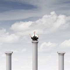 man sitting on column