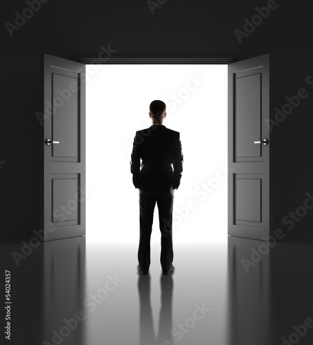 businessman and opened doors