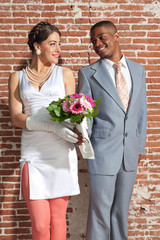 Vintage fashion romantic wedding couple in old urban building. H
