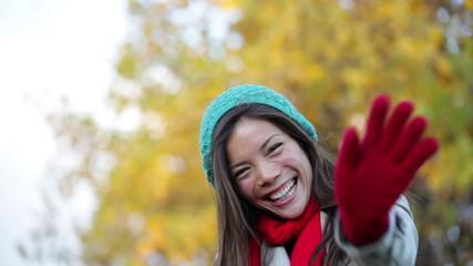 Fall woman waving hello and blowing a kiss